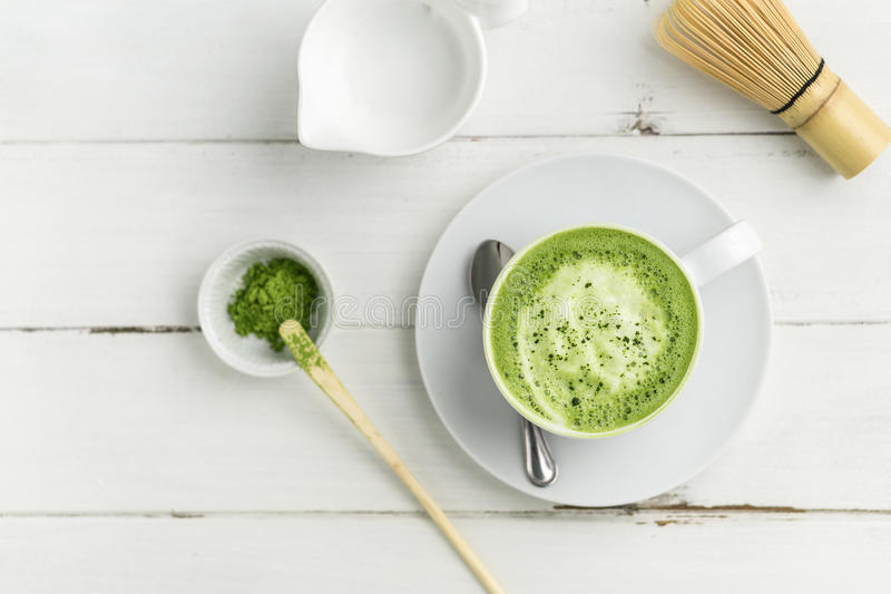 Green tea matcha latte cup on white background from above flat v royalty free stock images