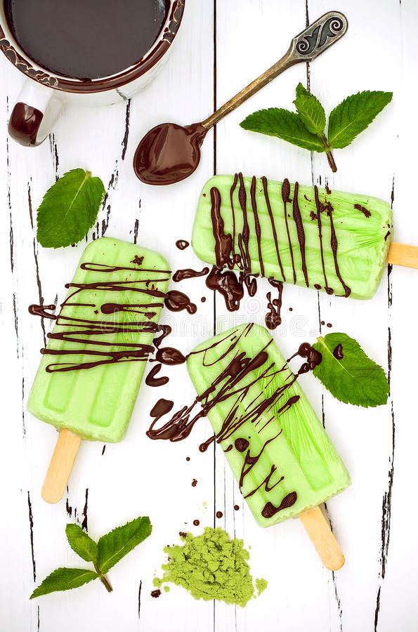 Green tea matcha mint popsicles with chocolate and coconut milk. Green tea matcha mint popsicles with chocolate and coconut milk royalty free stock photo