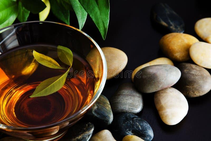 Green tea and pebbles royalty free stock photo
