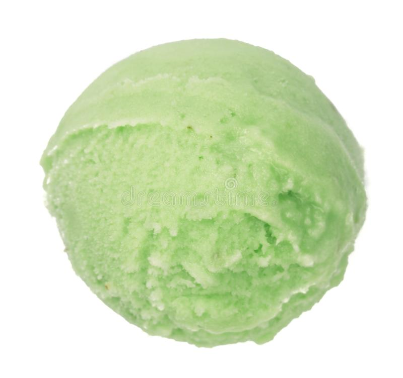Green tea or pistachio ice cream ball isolated on white background, top view.  stock image