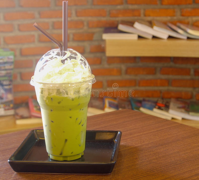 Green tea smoothies. With cream in cafe royalty free stock images