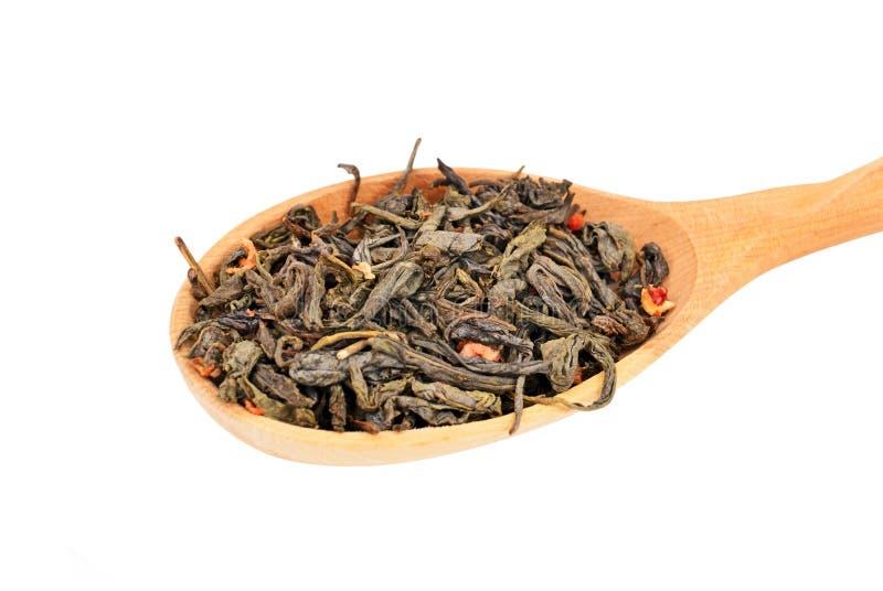 Green tea in wooden spoon stock image