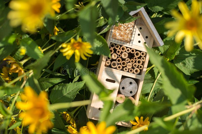 Insect hotel house in garden royalty free stock photography