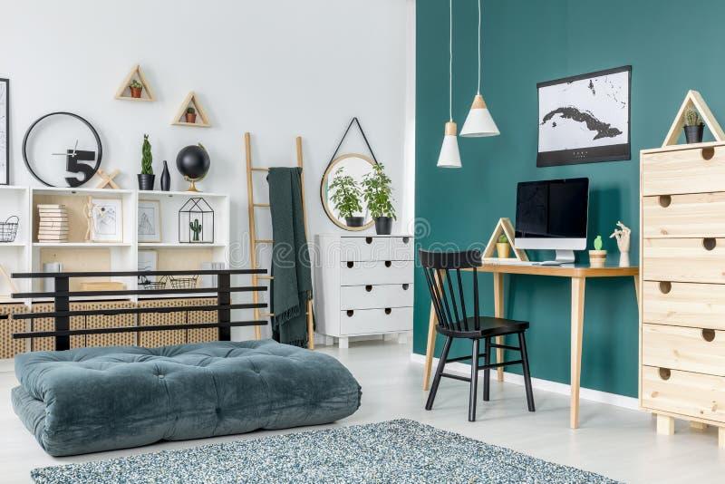 Green teenager`s room interior stock photos