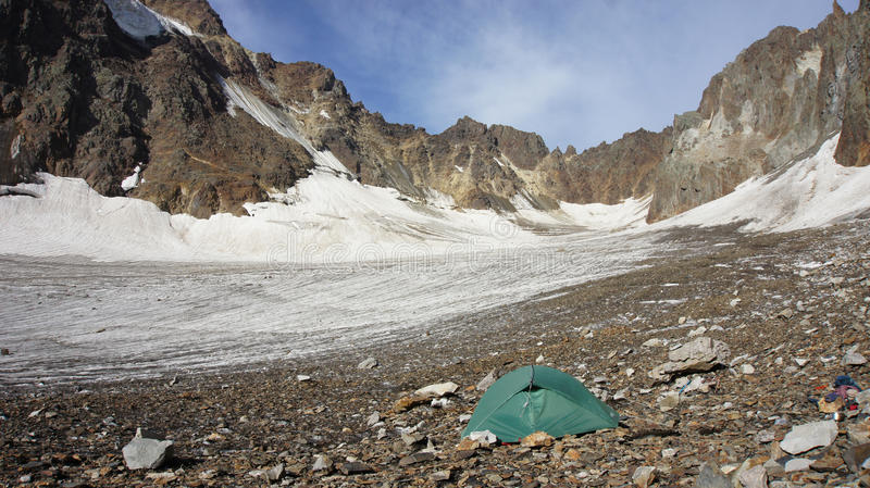 Green tent at glacier Greater Caucasus Mountain Range stock images