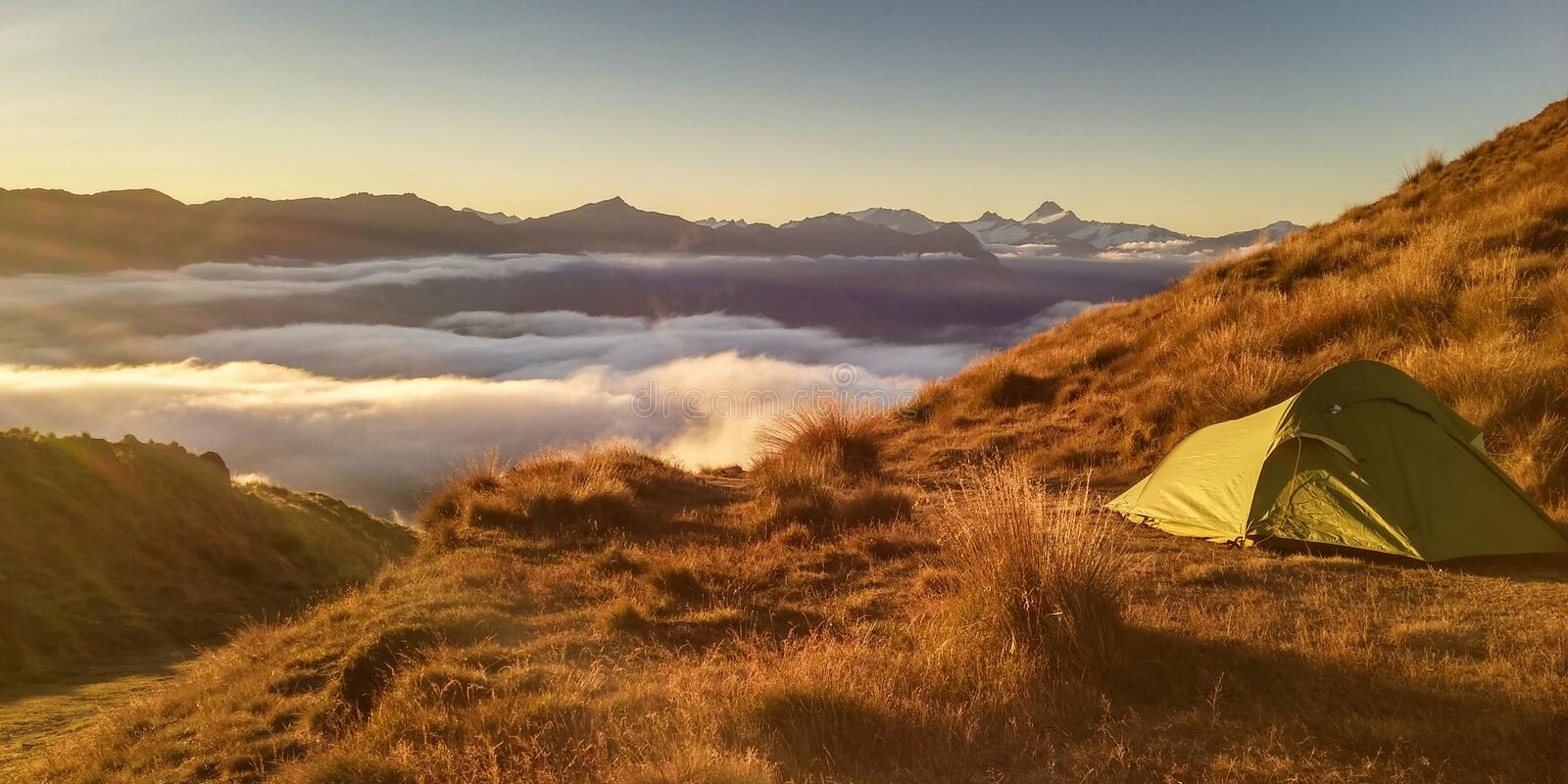 Green Tent On Top Of Mountain royalty free stock photo