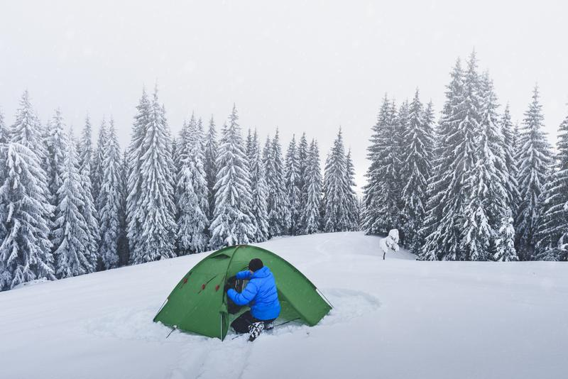 Green tent in winter mountains royalty free stock images