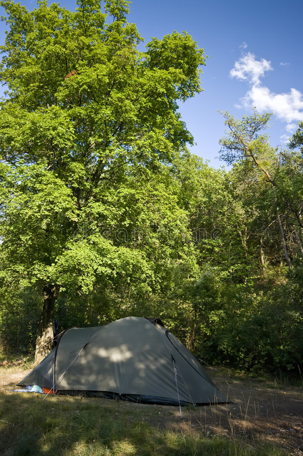 Green tent under tree stock photos