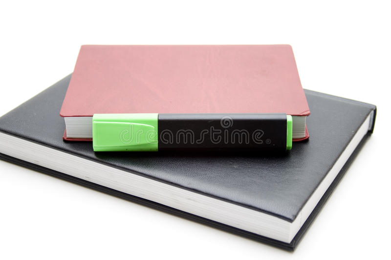 Green text marker on book royalty free stock photo
