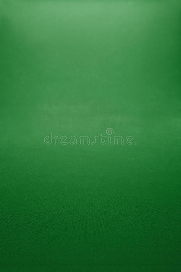 Green textile background. Game table royalty free stock photography