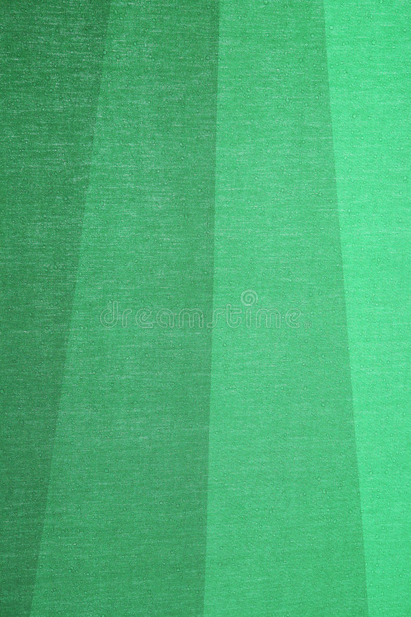 Green textile background. A green textile background - the stripes are part of a wet umbrella stock image