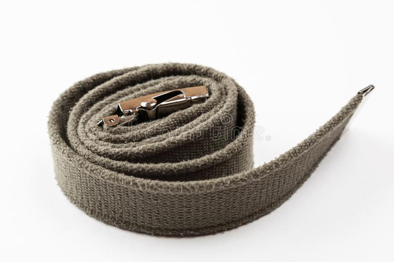 Green textile military belt on a white background.  royalty free stock image
