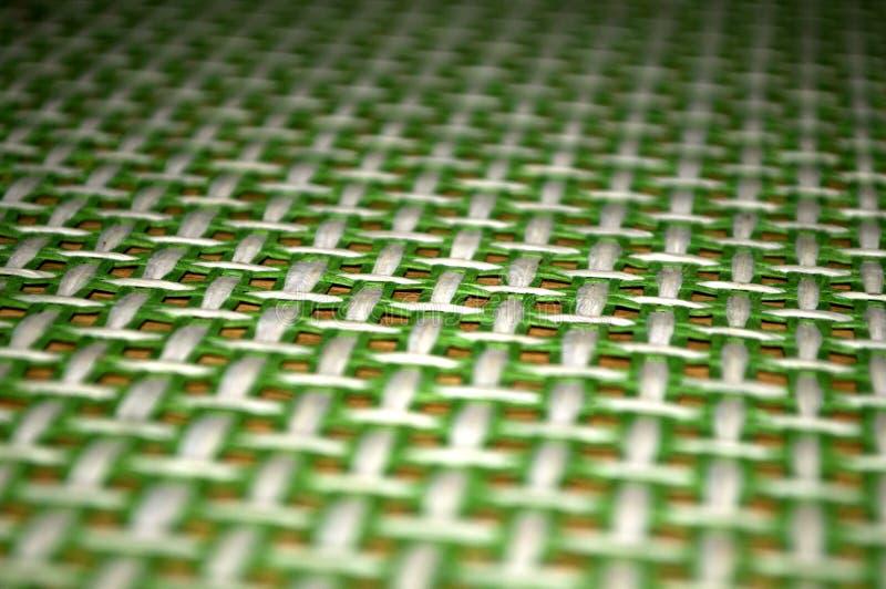Green texture tablecloth on wooden table. Novi Sad, Serbia royalty free stock image