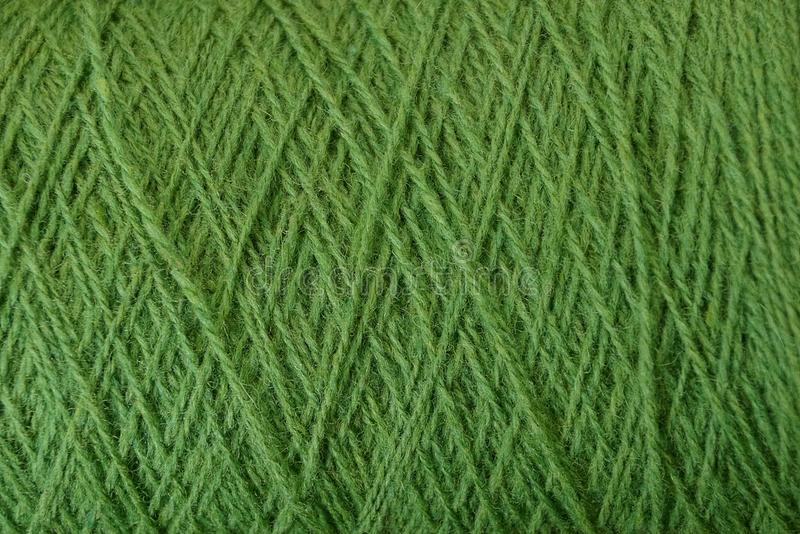Green texture of thick woolen threads. Green background of thick woolen threads royalty free stock photography
