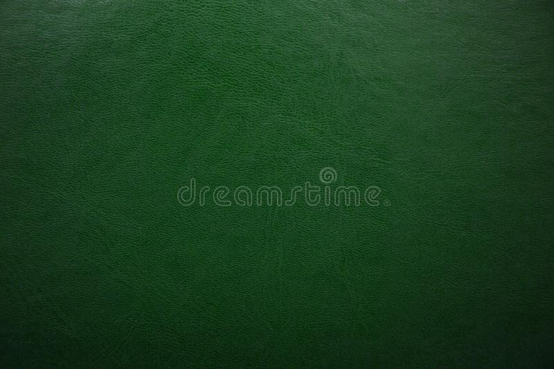 Green textured leather background. Abstract leather texture royalty free stock photos