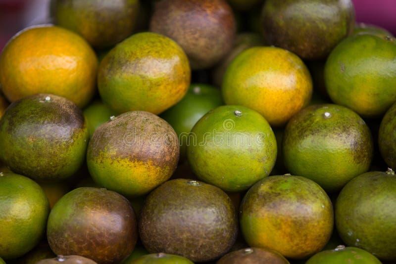 Green Thai oranges royalty free stock images