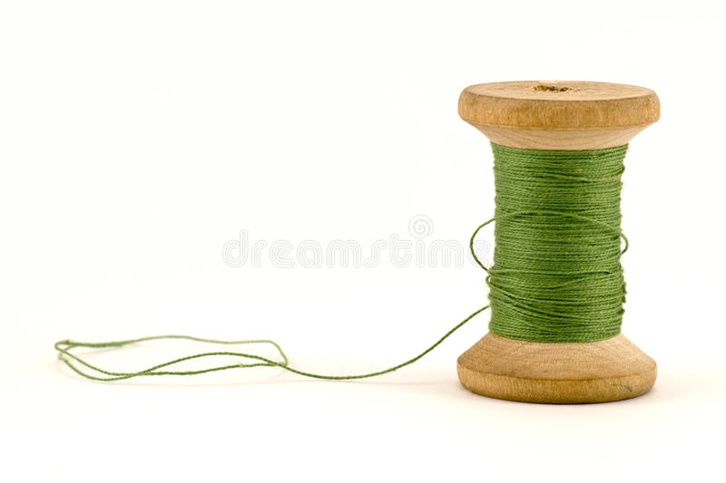 Green thread spool royalty free stock photos