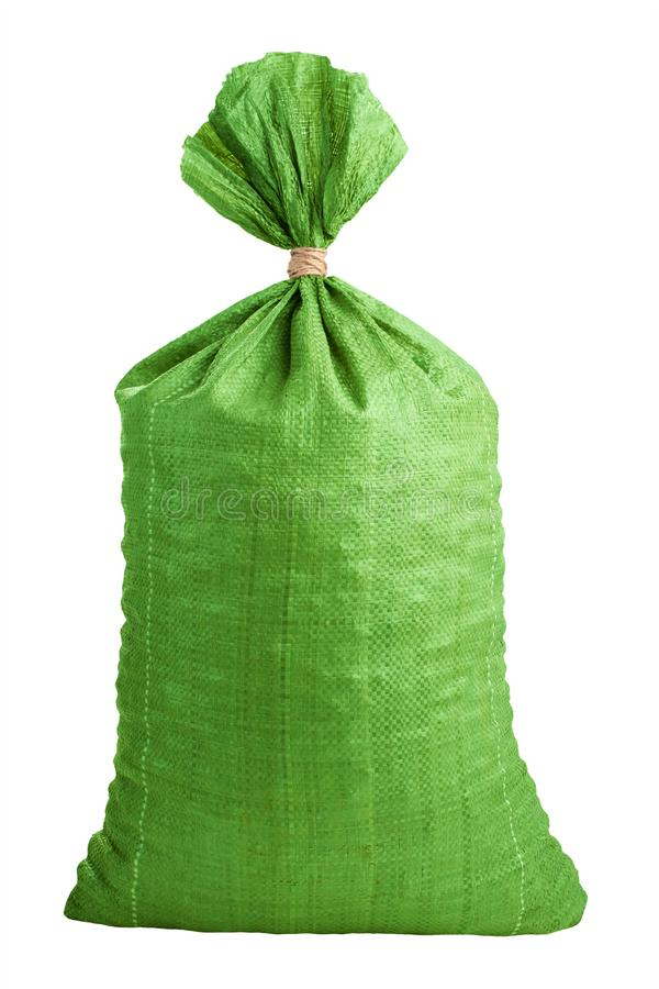 Tied up bag. Green tied up bag isolated on white background. Bagful on white royalty free stock photography