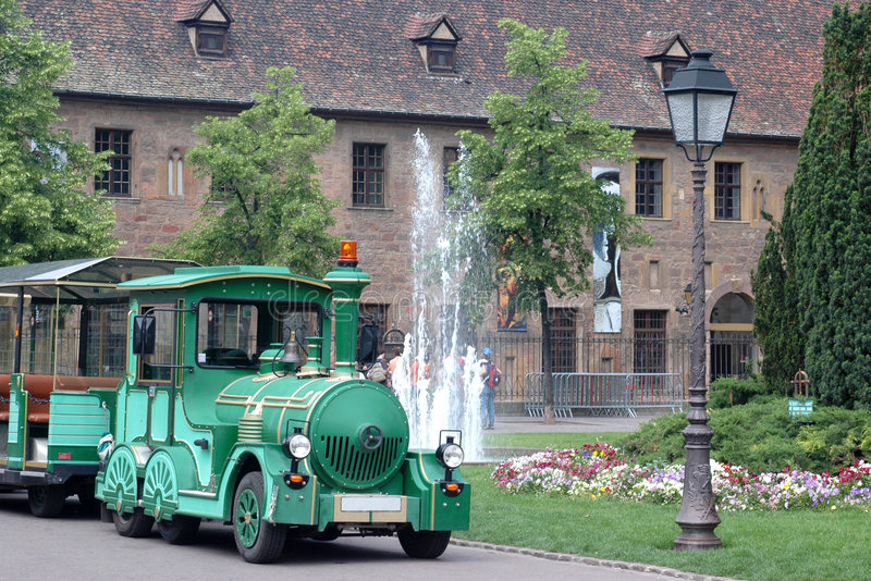 Green tourist train. A green tourist train in Colmar for visit the city stock photos