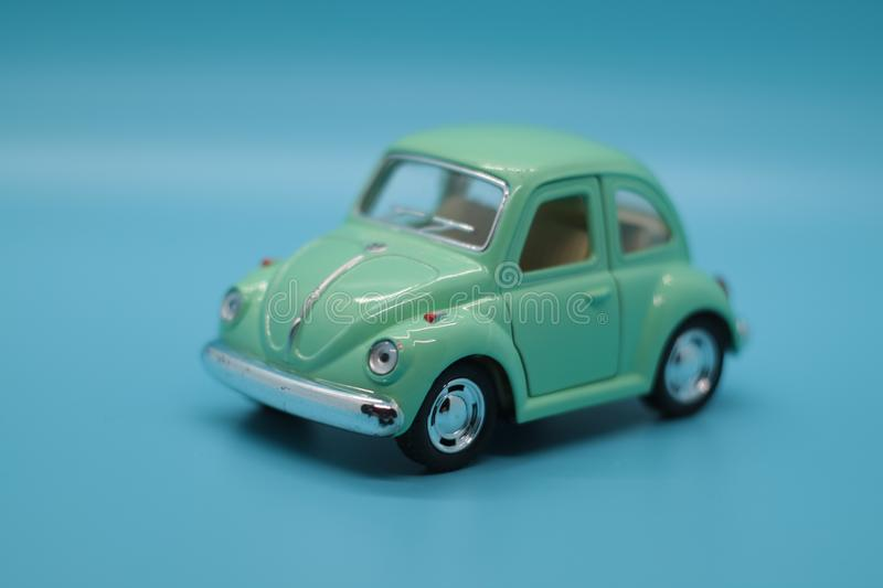 Green Toy Car - Volkswagen Beetle royalty free stock photo