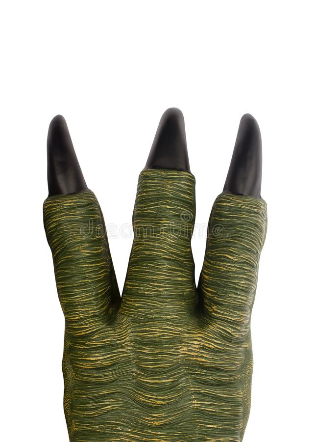 Green toy monster paw with black claws royalty free stock images