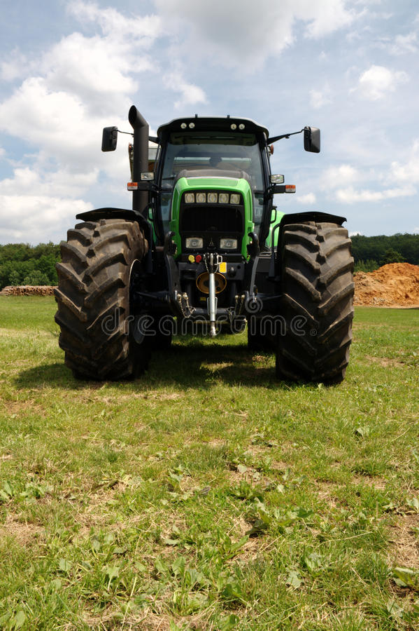 Download Green Tractor On Grass Royalty Free Stock Image - Image: 24687976