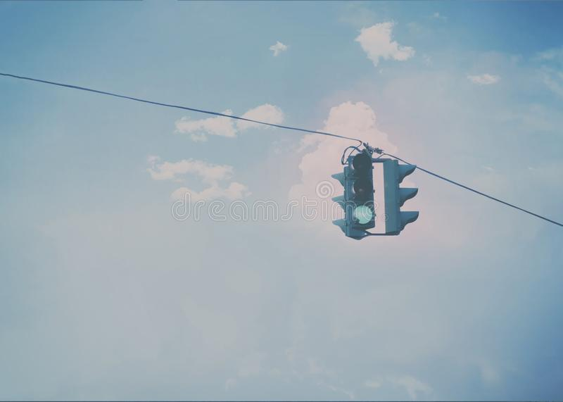 Green traffic light. Against the clouds royalty free stock images