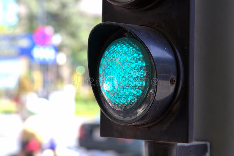 Green traffic light in Saigon royalty free stock image