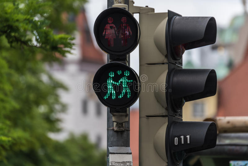 Green traffic light with a same-sex couple symbol. In Munich to celebrate pride week royalty free stock photography
