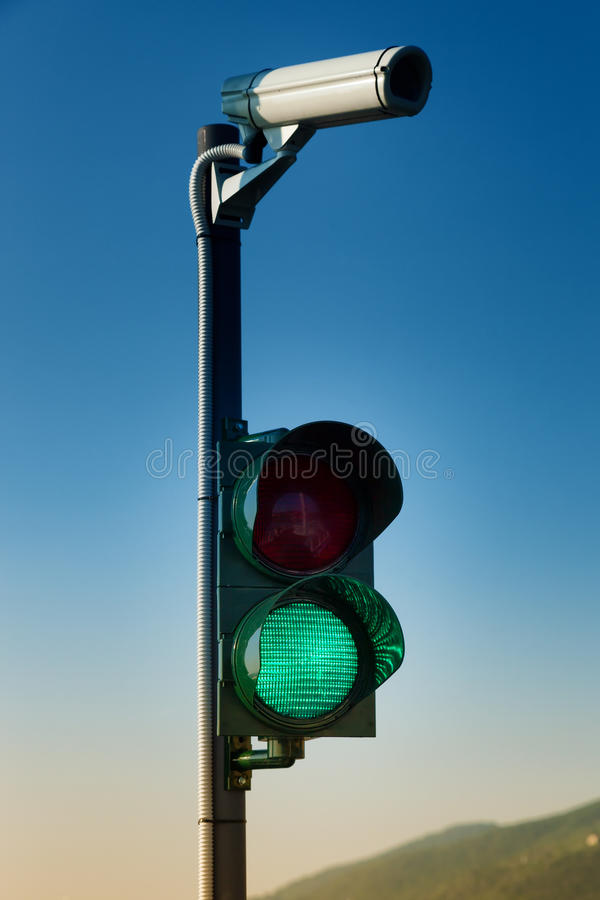 Green on traffic light with security camera stock image image of download green on traffic light with security camera stock image image of industrial green aloadofball Image collections