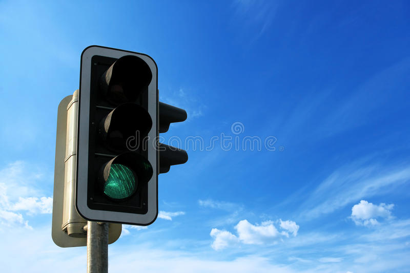 Green Traffic Light with sky, business freedom concept.  royalty free stock image