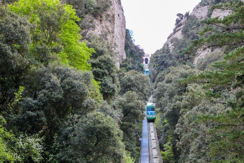 Green tramway in mountain landscape, Montserrat, near Barcelona, Spain royalty free stock image