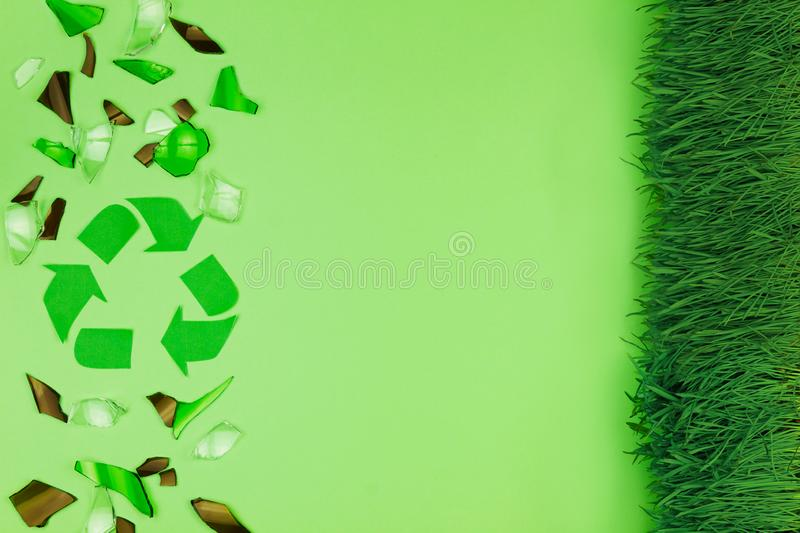 Green trash bin with shattered glass royalty free stock image