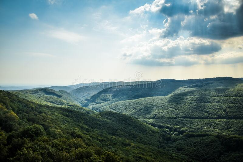 Green Tree Coated Mountain Under White and Blue Cloudy Sky at Daytime royalty free stock photos