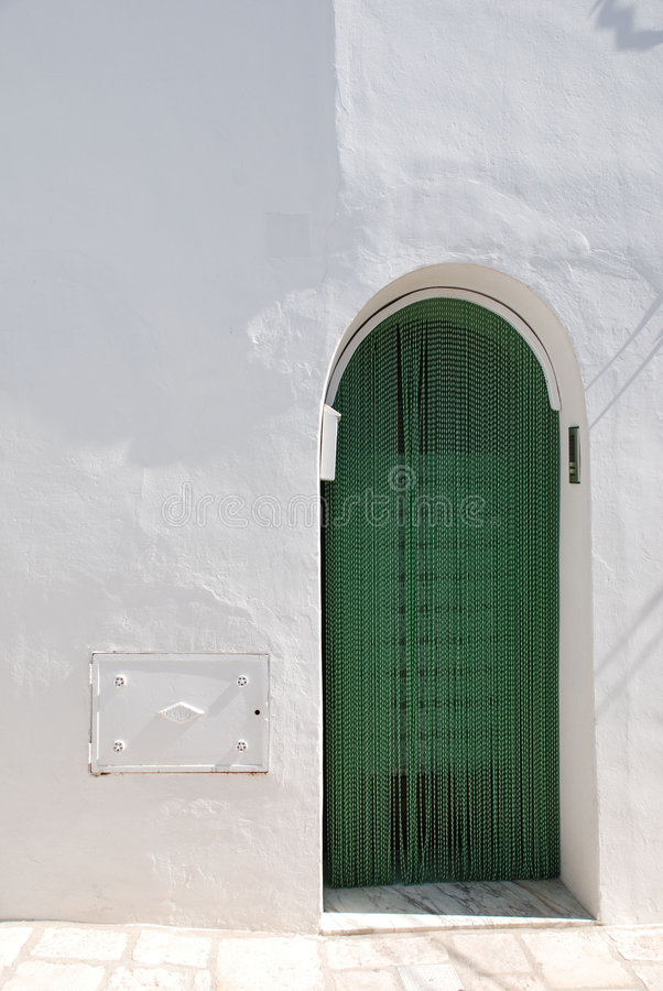 Green Trullo Door. The door of a trullo in Alberobello in Puglia, southern Italy. The trulli, which are protected under UNESCO World Heritage laws, are royalty free stock photos