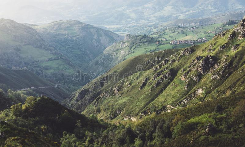 Green valley on background dramatic sky and clouds. Panorama horizon view of scenery foggy hills Northern Spain alps. Travel royalty free stock photos