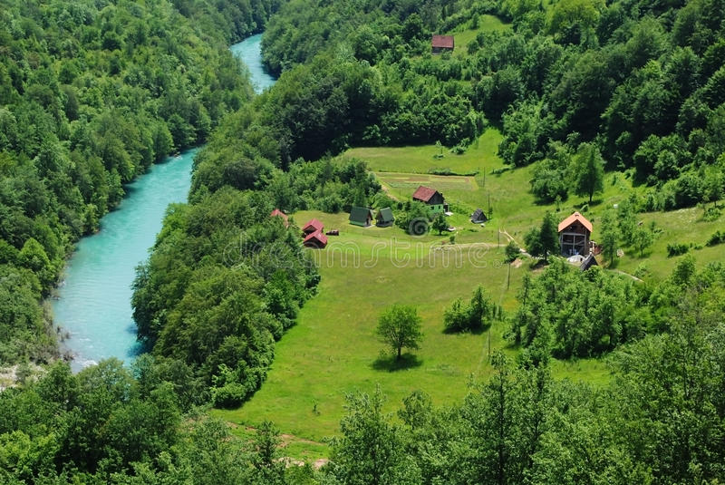 Green valley. And blue river stock image