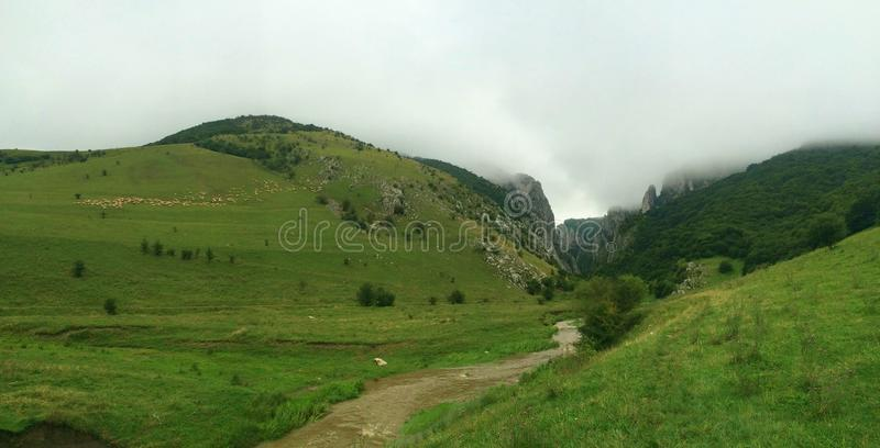 Green valley with clouds and fog in Turda, Transsylvania, Romania.  royalty free stock photography