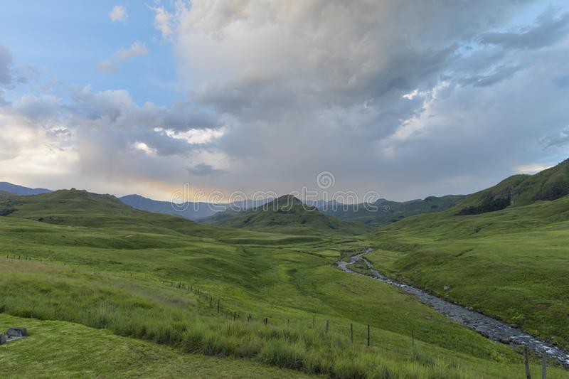 Green valley and clouds at sunset. Drakensberg South Africa stock photo