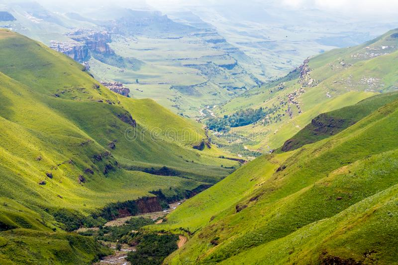 Green valley in Lesotho. Green valley in the Drakensberg Mountains in Lesotho. View from Sani Pass road in South Africa border stock images