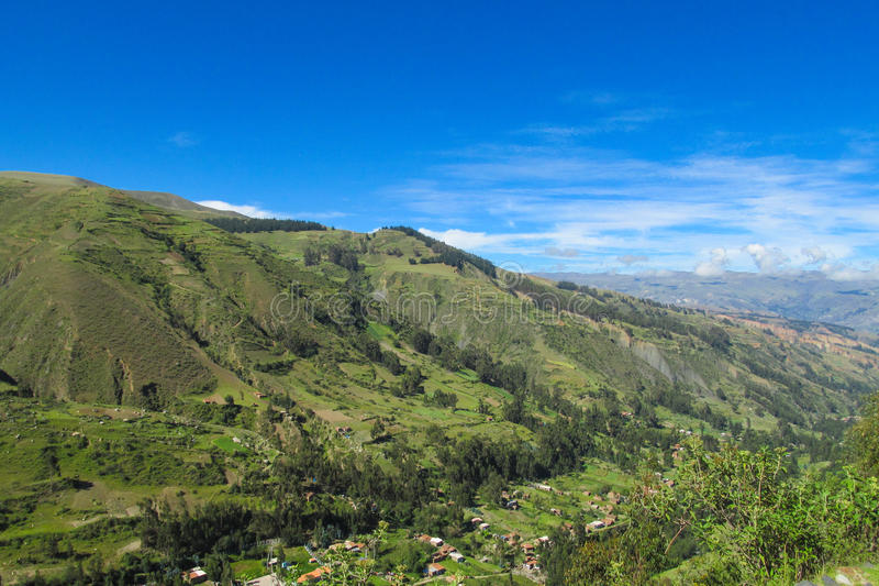 Green valley landscape. Green valley hills and village landscape stock image