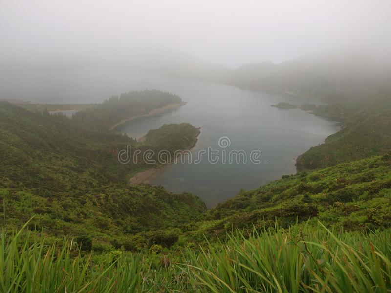 Azores S.Miguel Island Portugal. Green valley and mountains on the background.Fog and brume all over the landscape stock photo