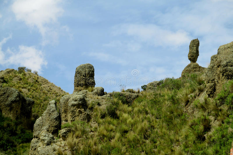 Green valley and rock formations near La Paz in Bolivia. Green valley and rock formations. Valle de las Animas rock formation cliff towers near La Paz in Bolivia stock photo