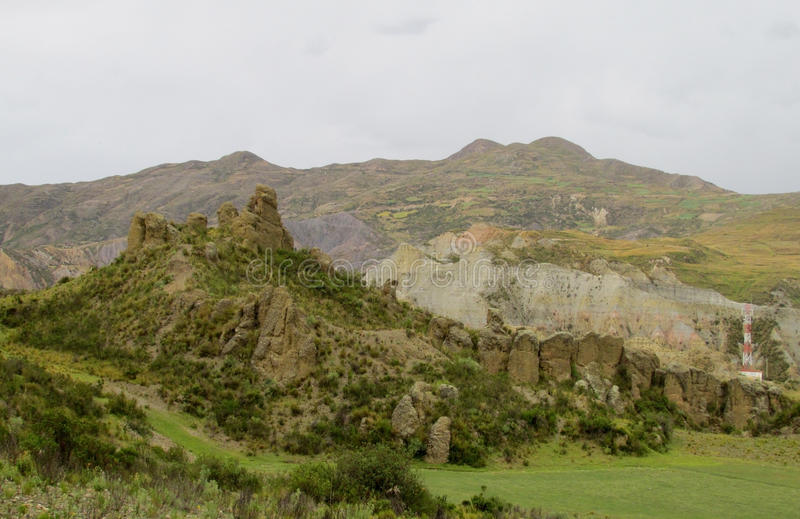 Green valley and rock formations under cloudy sky. Valle de las Animas rock formation cliff towers near La Paz in Bolivia. Cloudy weather royalty free stock photo