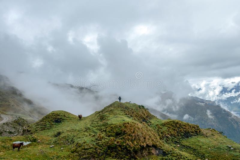 Green valley surrounded by mountains in clouds, Choquequirao trek between Yanama and Totora, Peru. Green valley surrounded by mountains in clouds, between Yanama royalty free stock photography