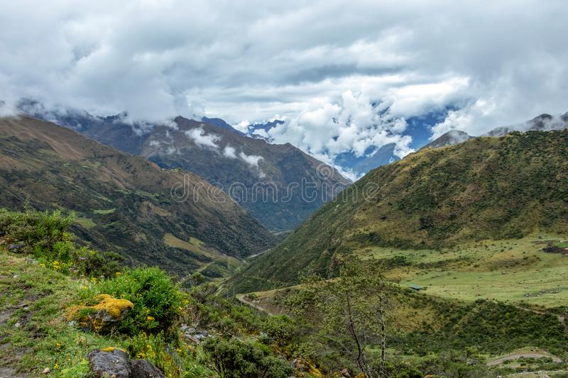 Green valley surrounded by mountains in clouds, Choquequirao trek between Yanama and Totora, Peru. Green valley surrounded by mountains in clouds, between Yanama stock image