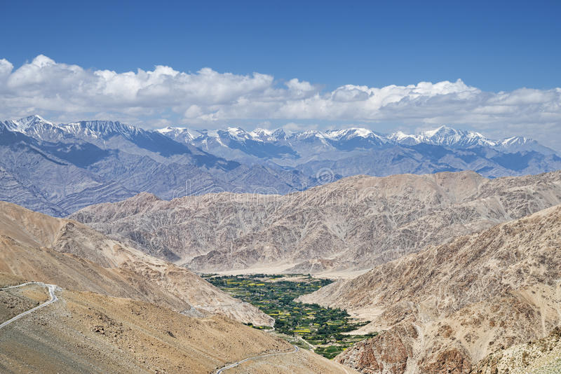 Green valley and winding road in Himalayas aerial view. In India royalty free stock photo