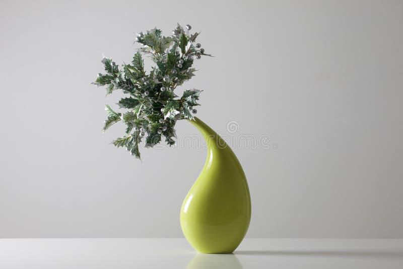 Green vase with Christmas adornment stock photos