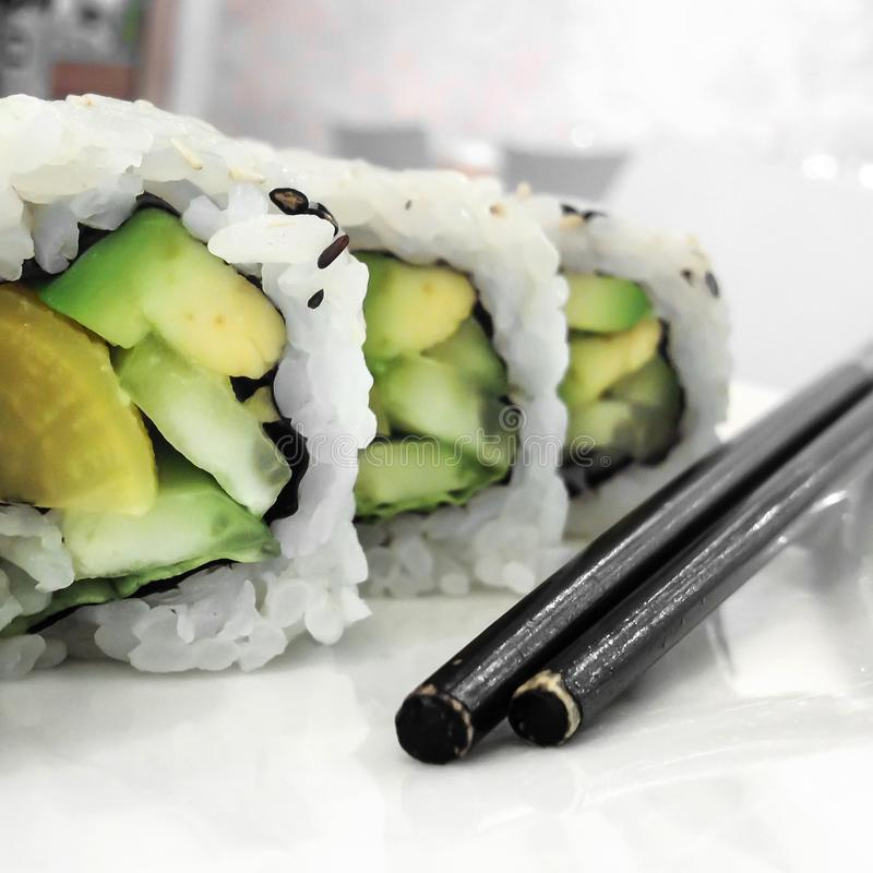 Green vegan sushi rolls with vegetables stock photography