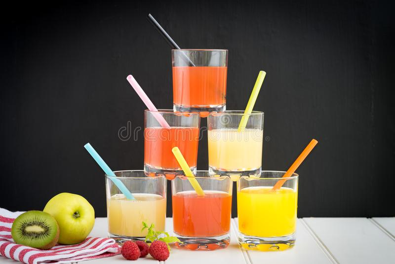 Green vegan vegetarian smoothie juice selection orange red apple royalty free stock images